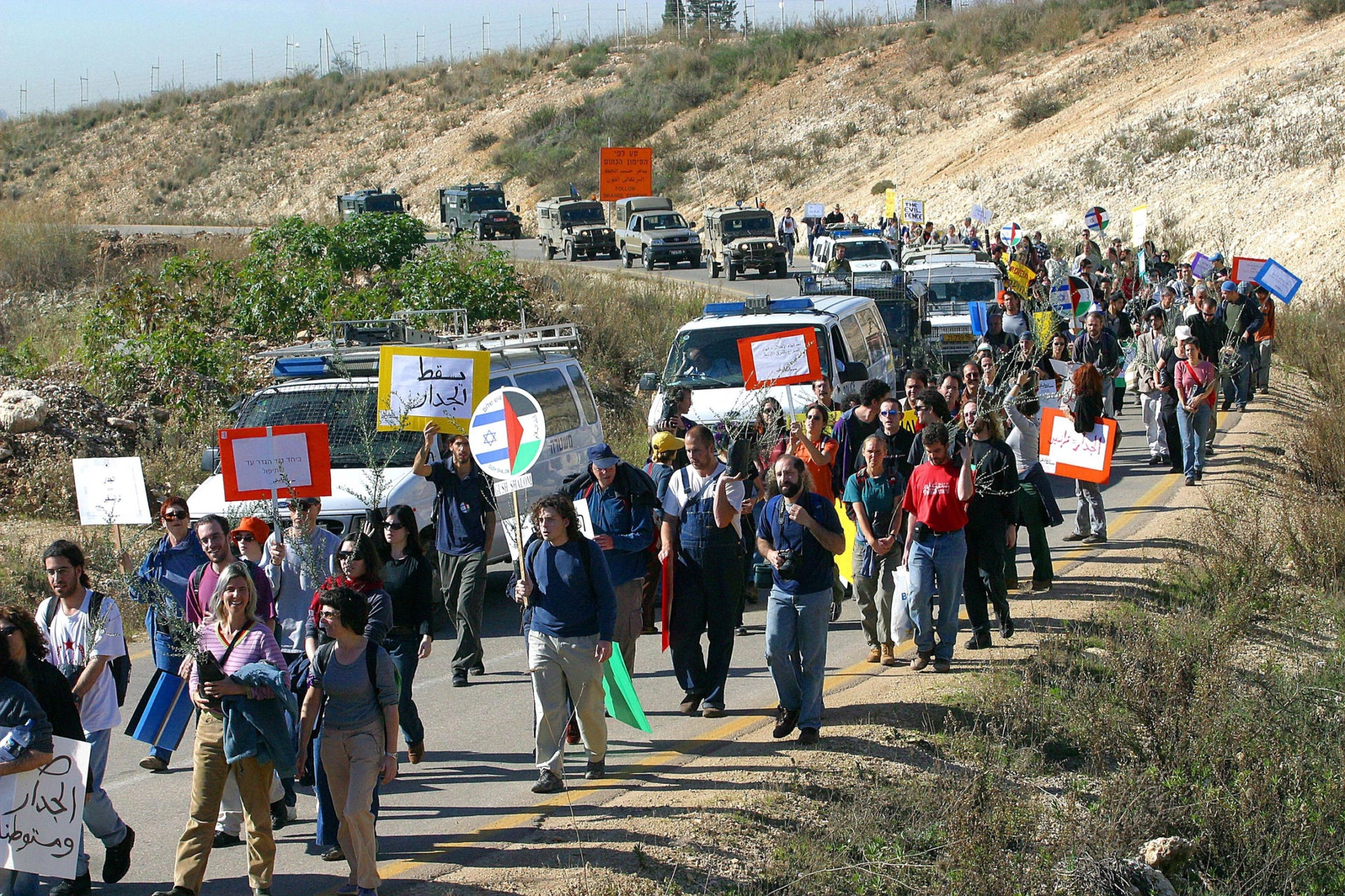 "A 2004 demonstration by members of the Ta'ayush anti-occupation movement. The word that recurs constantly when talking to activists who opted to leave Israel is ""despair."""