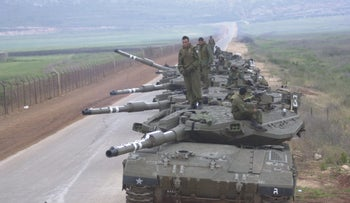 Israeli soldiers withdraw from Lebanon, May 2000.