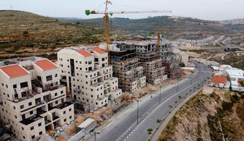 Construction works in the settlement of Givat Ze'ev, near Ramallah, May 13, 2020.