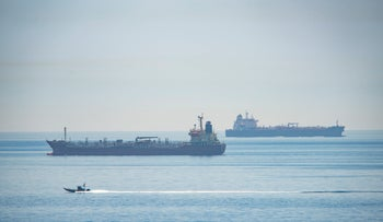 A view of the Iranian vessel the Clavel, right, sailing on international waters crossing the Gibraltar stretch, May 20, 2020.