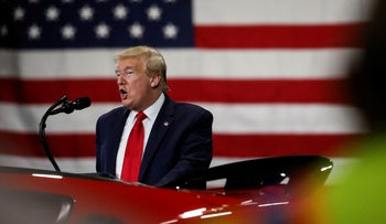 U.S. President Donald Trump addresses workers and guests during a visit at a Ford plant now making ventilators and medical supplies for the COVID-19 pandemic in Ypsilanti, Michigan. May 21, 2020