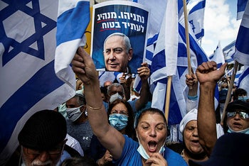 Supporters of Israeli Prime Minister Benjamin Netanyahu take part in a protest outside the Prime Minister's Residence, on the day when Netanyahu's corruption trial starts, in Jerusalem May 24, 2020.