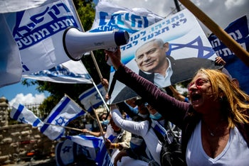 Benjamin Netanyahu supporters demonstrate outside the Jerusalem courthouse where the prime minister attended the first day of his trial, Jerusalem, May 24, 2020.