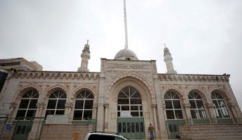 Gamal Abdel Nasser mosque is seen closed during Friday prayers over concerns of the spread of the coronavirus, Ramallah, March 20, 2020.