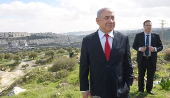 Prime Minister Benjamin Netanyahu stands at an overview of the Israeli settlement of Har Homa,  February 20, 2020.