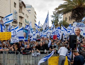 Netanyahu supporters protest against justice system outside the Jerusalem District Court on the first day of the PM's trial, May 24, 2020.