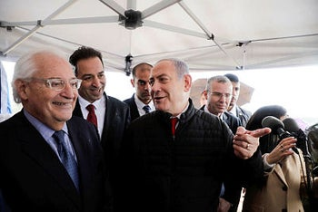 Netanyahu talks to the U.S. Ambassador David Friedman during his visit to Ariel settlement in the West Bank, February 24, 2020.