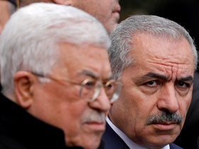 Palestinian PMMohammad Shtayyeh and President Mahmoud Abbas attend the funeral of former senior Fatah official Ahmed Abdel Rahman, in Ramallah, December 4, 2019.