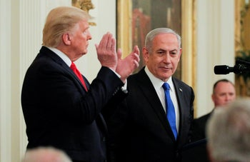 U.S. President Donald Trump applauds Prime Minister Benjamin Netanyahu at a news conference on the Middle East peace plan, Washington, January 28, 2020