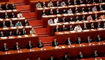 Chinese President Xi Jinping and other officials applaud after the vote on the national security legislation for Hong Kong at the Great Hall of the People in Beijing, China May 28, 2020.