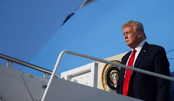 U.S. President Donald Trump deplanes from Air Force One as he returns to Washington after travel to the Kennedy Space Center in Florida at Joint Base Andrews, Maryland, U.S., May 27, 2020.