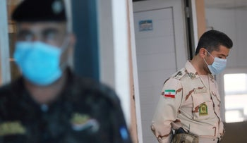 File photo: A member of Iranian Border Guards inside the Shalamcha Border Crossing, Iraq March 8, 2020.