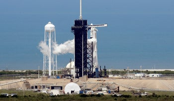 A SpaceX Falcon 9, with NASA astronauts Doug Hurley and Bob Behnken in the Dragon crew capsule, prepare to lift off as the vehicle vents fuel, from Pad 39-A at the Kennedy Space Center in Cape Canaveral, Florida, May 30, 2020.