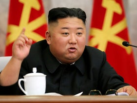 Kim Jong Un speaks in an image released by North Korea's Korean Central News Agency (KCNA) on May 23, 2020.