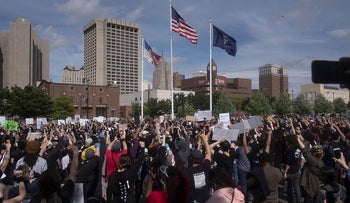 Protesters gather to protest the recent killing of George Floyd on May 29, 2020 in Detroit, Michigan. Demonstrations are being held across the US after George Floyd died in police custody on May 25th