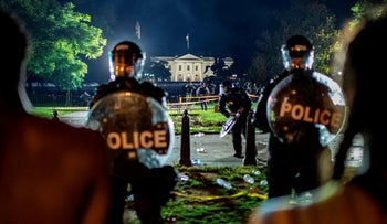 Demonstrators confront secret service police and Park police officers outside of the White House on May 30, 2020 in Washington DC, during a protest over the death of George Floyd
