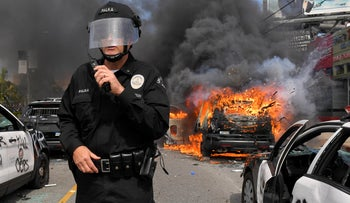 LAPD commander Cory Palka standing among several destroyed police cars during a protest over the death of George Floyd, May 30, 2020, in Los Angeles.