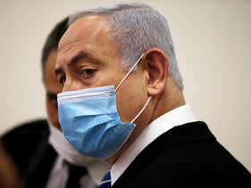 Prime Minister Benjamin Netanyahu arrives at the Jerusalem District Court to attend the first session of his corruption trial, May 24, 2020.