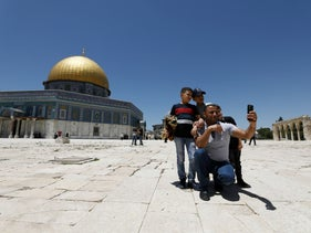 People take a selfie next to al-Aqsa mosque compound after a two-and-a-half month closure due to coronavirus disease (COVID-19), in Jerusalem's Old City May 31, 2020.