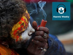 A Hindu holy man smokes marijuana during Shivaratri festival in Kathmandu, Nepal, in Feb 2020.