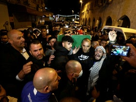 People attend the funeral of Eyad Hallaq in Jerusalem, May 31, 2020