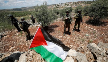 Israeli troops stand guard during a Palestinian protest against Israeli settlements, near Salfit, West Bank, May 29, 2020