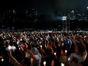Thousands of people take part in a candlelight vigil to mark the 30th anniversary of the crackdown of pro-democracy movement at Beijing's Tiananmen Square in 1989, at Victoria Park in Hong Kong, June 4, 2019.
