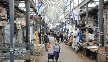 The Ramla market is seen partially closed due to the spread of the coronavirus, April 23, 2020.