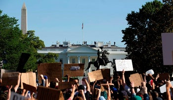 Demonstrators hold up placards protest outside of the White House, over the death of George Floyd in Washington D.C. on June 1, 2020