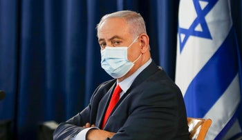 Netanyahu, wearing a face mask, chairs the weekly cabinet meeting in Jerusalem on May 31, 2020.