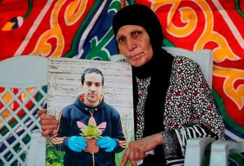 The mother of Eyad Hallaq mourns her son at their home in East Jerusalem, June 1, 2020.