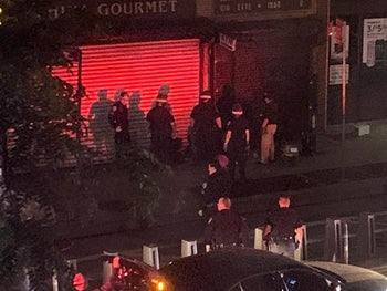 The view from P.'s apartment in Midtown West with police officers on the street below.