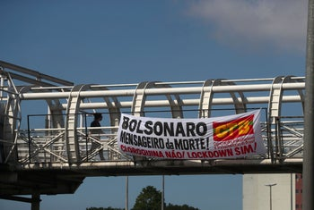 A banner reading 'Bolsonaro, Messenger of Death! Hydroxychloroquine no, lockdown yes!' hangs from a bridge, as the spread of the coronavirus continues, in Rio de Janeiro, Brazil, May 25, 2020