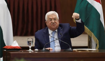 Palestinian President Mahmoud Abbas heads a leadership meeting at his headquarters, in the West Bank city of Ramallah, Tuesday, May 19, 2020