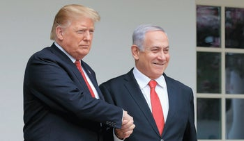 Benjamin Netanyahu shakes hands with Donald Trump on a visit to the White House, March 25, 2019.