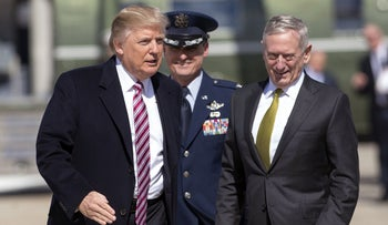 Trump greets then-Secretary of Defense James Mattis as he walks to board Air Force One prior to departing from Andrews Air Force Base in Maryland, March 3, 2017