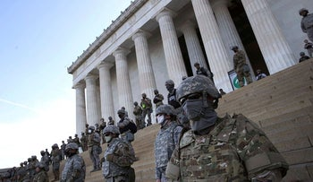 Members of the D.C. National Guard stand on the steps of the Lincoln Memorial as demonstrators participate in a peaceful protest against police brutality and the death of George Floyd, on June 2, 2020 in Washington, DC