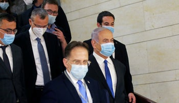 Prime Minister Benjamin Netanyahu wears a protective face mask on his way to the swearing-in ceremony of the unity government, Jerusalem, May 17, 2020