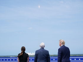 President Donald Trump, right, with Vice President Mike Pence and his wife Karen, watching the launch of SpaceX, in Florida.