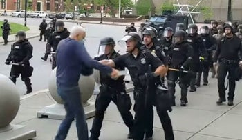 In this image from video provided by WBFO, a Buffalo police officer appears to shove a man who walked up to police Thursday, June 4, 2020, in Buffalo, N.Y.
