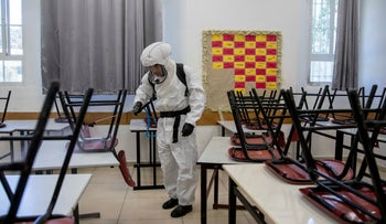 A worker sanitizing a classroom in a school in Jerusalem, June 3, 2020.