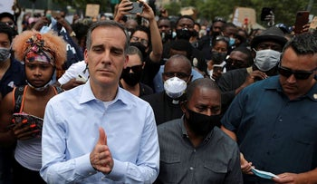 Mayor of Los Angeles Eric Garcetti stands next to demonstrators during a protest against the death in Minneapolis police custody of George Floyd, in Los Angeles, California, U.S. June 2, 2020