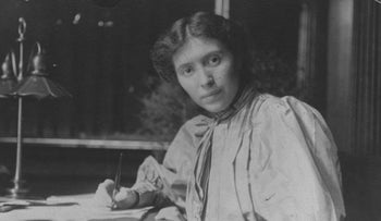 Rose Pastor Stokes pictured at her desk in 1906.