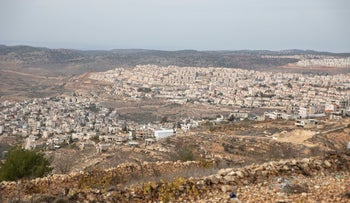 A view showing the Palestinian village of Nahalin on the left and the settlement of Betar Ilit, December 2019.