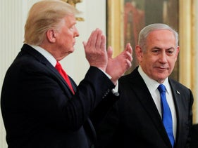 Donald Trump applauds Benjamin Netanyahu as they appear together at a joint news conference at the White House, January 28, 2020.