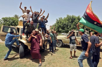 Fighters loyal to Libya's UN-recognised Government of National Accord (GNA) celebrate retaking the town of Tarhouna, 65 kilometres southeast of Tripoli, from Haftar's forces, June 5, 2020.