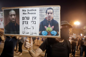 Protesters attend a rally against Israel plans to annex parts of the West Bank, in Tel Aviv, Israel, June 6, 2020.