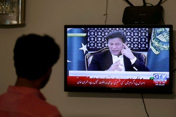 A television screen displays Prime Minister of Pakistan Imran Khan, announcing the extension of a country-wide coronavirus lockdown. Karachi, Pakistan, April 14, 2020
