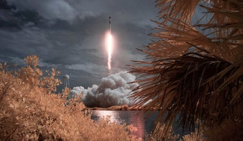 Photo provided by NASA: SpaceX Falcon 9 rocket carrying the company's Crew Dragon spacecraft seen in false color infrared exposure as it is launched on NASA's SpaceX Demo-2 mission to the International Space Station with NASA astronauts Robert Behnken and Douglas Hurley onboard, Saturday, May 30, 2020, at NASA's Kennedy Space Center in Cape Canaveral, Florida.