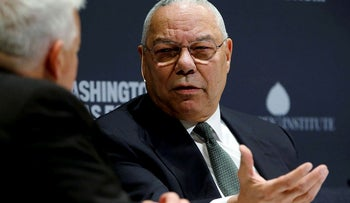 Former U.S. Secretary of State Colin Powell (R) takes part in an onstage interview with Aspen Institute President and CEO Walter Isaacson (L) at the Washington Ideas Forum in Washington, September 30, 2015